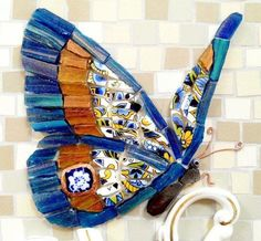 Butterfly mosaic with combination of patterned tile and glass