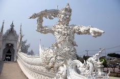 white temple guards - Google Search Chiang Rai Thailand, White Temple, Going On Holiday, Buddhist Temple, Art And Architecture, Amazing Art, Statue Of Liberty, Places To Go, Exotic