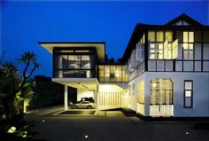 Colonial Black and white house with modern extension in Singapore