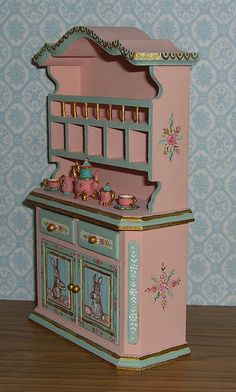 Just finished painting this hutch in soft spring colors of peachy pink and sea glass green. Sweet little bunnies having tea and carrot cake of course (after Beatrix Potter) are hand painted on the door panels. | eBay!