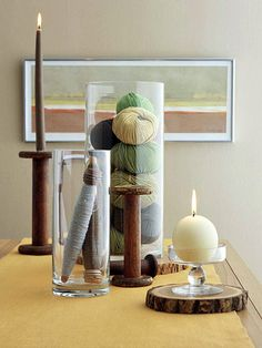 Whether formal or rustic, Colonial-style interiors have one unifying thread: the look of handcrafting in every element.  For a cozy homespun touch, fill a tall glass vase with balls of colored yarn. Pair them with wooden spools -- some placed in a vase, others fashioned into candlesticks.