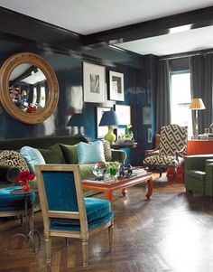 "Dark and Moody Living Room    In a Manhattan apartment designed for a couple in the fashion world, Miles Redd lacquered walls in Farrow & Ball's Hague Blue, ""a great way to do a moody color because of the way it reflects light. It doesn't look dark so much as rich."" Featured in July 2009 issue."