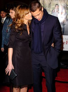 Jennifer Aniston & Brad Pitt January 2004 - Jen shared a private moment with Brad while on the red carpet for her Along Came Polly premiere in Hollywood