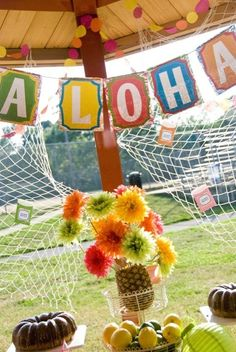 luau party--- could make this banner from craft paper.  Add Chinese lanterns and tissue paper flowers.