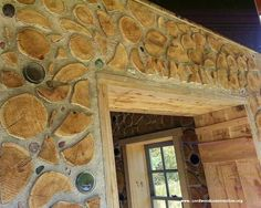 """The cabin's """"build date"""" is done in cordwood Roman Numerals!  Look above the door frame."""