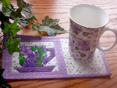Quilted mug rug. Would make a lovely handmade gift especially if designed around an accompanying mug.