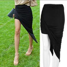 NWOT Asymmetric Skirt Sexy black asymmetrical skirt.  Wrap design gives a slimmer illusion.  Never worn. Skirts Asymmetrical