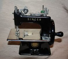 Child size Singer sewing machine. So sweet!