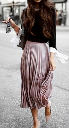Top with bow details on the sleeve, metallic pleated skirt, & pumps - adore this fall outfit idea