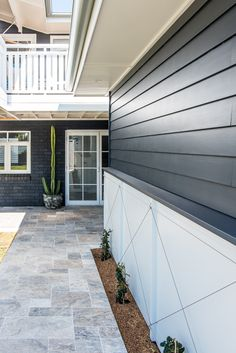 Travetine from Beaumont Tiles. Cemintel product on lower garage with star jasmin in criss cross Exterior Tiles, Exterior Colors, Black Exterior, Outdoor Tiles, Outdoor Flooring, Facade Design, House Design, Fence Design, Grafton House