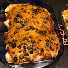 Best Beef Enchiladas - Tried and true! I made a few modifications: 1 lb of ground beef, half an onion, a whole packet of taco seasoning, and no black pepper, salt, or olives. For the enchilada sauce, I added a small can to the beef mixture, then spooned about half the other can over the top of the enchiladas. Great dish!