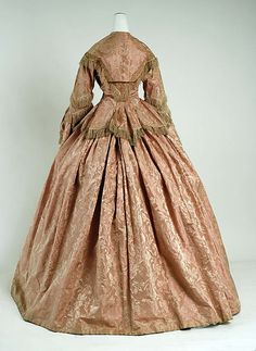 Dress Date: ca. 1856 Culture: British Medium: silk Dimensions: Length at CB (a): 26 3/4 in. (67.9 cm) Length at CF (b): 40 1/2 in. (102.9 cm) Credit Line: Purchase, Irene Lewisohn and Alice L. Crowley Bequests, 1982