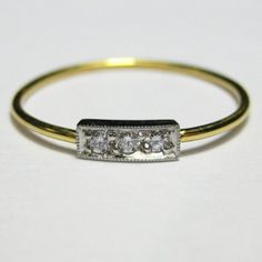 Simple, subtle, love it! Svea a Platinum 22K Gold and Diamond Ring by JewelerOnTheRoof, $460.00
