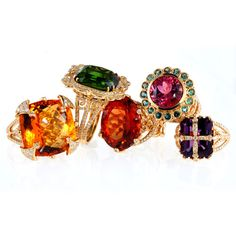 From left to right: 18k Gold and Diamond Kathryn Ring with Citrine Centre, 18k Gold and Diamond Shayne Ring with Green Tourmaline Centre, 18k Gold and Diamond Angelina Ring with Orange Tourmaline Centre, 18k Gold and Diamond Emily Ring with Rose Tourmaline Centre and Alexandrite Bezel, 18k Gold and Diamond Shannon Ring with Amethyst Centre. 323.938.2373