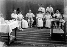These photos are over 100 years old. They are from the British Imperial reign of India. This is a photo from a daily scene the Brits just relaxing at a tennis club. Lemonade is on the stand.