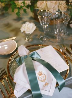 Gorgeous gold monogrammed napkins tied with ribbon.