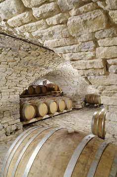 "Les #caves du château #Cazeneuve, où patientent des #fûts de Pic-Saint-Loup.  We'll make a note from this winery in: ""how to design wine production caves"""