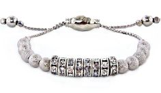 We love this pull cord bracelet! Sophisticated yet urban, the crystal and metal are a great combination.