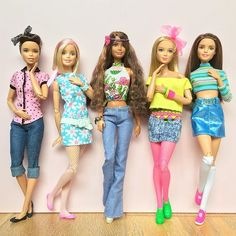 Through the decades. 50's - 60's - 70's - 80's - 90's Dolls L-R: Fashionista on M2M body, M2M Barbie, Petite Fashionista on 'Swappin' Styles' body, Tall Fashionista on M2M body  and M2M Teresa. #barbie #barbiedoll #barbiestyle #barbiefashionista #tallbarbie #petitebarbie #barbiemadetomove #madetomovebarbie #barbieclothes #mattel #dollclothes #dollstagram #dollphotogallery #throughtheyears #throughthedecades #vintagestyle #retroclothing