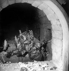 """Inside 1945 Buchenwald with LIFE: """"The remains of an incinerated prisoner inside a Buchenwald cremation oven, April 1945"""""""