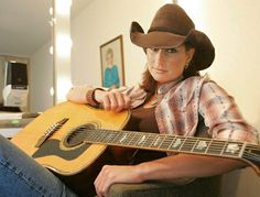 Teri Clark relaxes in her dressing room backstage at the Grand Ole Opry in this 2004 file photo. (John Russell/AP)