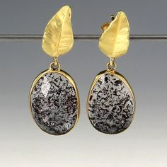 """A pair of18k yellow gold moss amethyst earrings with wavy gold leaf tops. Total length measures 1 1/4"""". by Barbara Heinrich"""