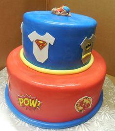 Calumet Bakery Superhero themed two tier with gum paste baby topper.