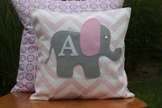 Modern Grey and Pink Elephant Chevron Pillow Cover. $20.99, via Etsy. Realy like except needs an L instead of an A