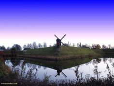 Bourtange is a star-shaped fort and village in the Westerwolde region of the Dutch province of Groningen.  Here we see its windmill. ~ Photo by Maria Mellou