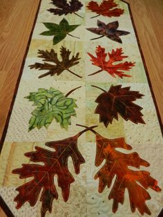 "Fall Table Runner, Fall Leaf Table Runner, Batik Fabric Table Runner 14 x 34"". $60.00, via Etsy."
