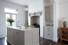Hardwick White from farrow and ball.  very nice with the darker floors.