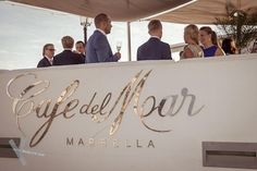 Wedding guests enjoying a glass of champagne on the beautiful terrace of Cafe del Mar Marbella. Stylish weddings Wedding photography by Kris Mc Guirk.Destination weddings with style. Glass Of Champagne, Destination Weddings, Beach Club, Terrace, Ireland, Spain, Wedding Photography, Stylish, Beautiful