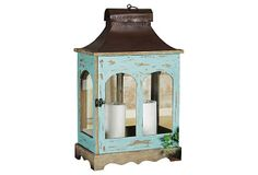 Lovely wood and metal lantern holds two candles from One Kings Lane. A pair would look great on our second floor balcony.