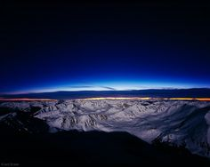 Moonlit mountains and the last colors of sunset, as seen from the summit of Mt. Elbert, the tallest mountain in Colorado at 14,440 feet, Sawatch Range, February.