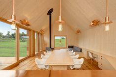 In this house designed byKühnlein Architektur in Bavaria, two gabled structures unified with wooden lamellas creates two yards outside and a a comfortable living atmosphere inside.