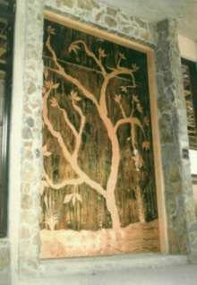 Door with tree carving