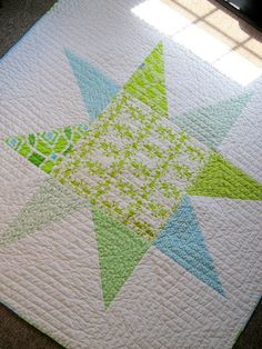 Wonky star baby quilt