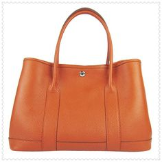 Hermes,Hermes (every time I see an Orange purse it makes me think of Rachel G!  Lol..... Is it just me or are they everywhere now!)