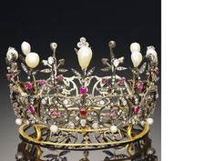 A 19th century ruby, natural pearl and diamond crown, circa 1890 The openwork circlet of scrolling foliate design set throughout with rose and old brilliant-cut diamonds, with cushion-shaped ruby highlights, culminating in alternating claw-set diamonds and pear-shaped pearl finials, inner circumference 26.0cm.