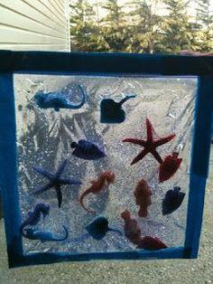 Manualidad el mar: gel de ducha, purpurina, bolsa transparente y celo