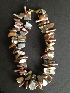 Peach coral stick beads and mother-of-pearl beads by SylviaGottwald, $350.00