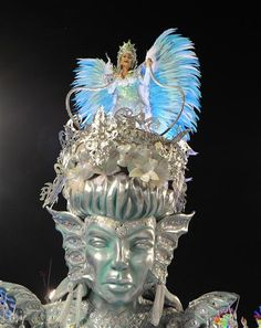 Rio Carnival - Photo gallery - A reveller of Imperatriz samba school performs on a float during the first night of carnival parade at the Sambadrome in Rio de Janeiro on February 20, 2012. AFP PHOTO / ANTONIO SCORZA AFP PHOTO / ANTONIO SCORZA