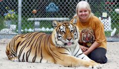 Woman shares backyard with two Bengal tigers and they're as loving and playful as kittens