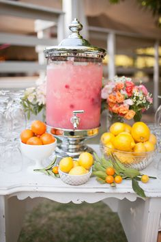 i love this beverage station, using on a distressed vintage dresser. accenting the pink colored drink by placing fruits in bowls around, is an inexpensive way to add some more color.                      walking on sunshine :)