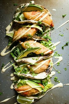 Crispy Salmon Fish Tacos - Foodness Gracious - - Crispy beer battered salmon tacos with fresh greens and avocado sour cream. Salmon Recipes, Fish Recipes, Seafood Recipes, Mexican Food Recipes, Dinner Recipes, Cooking Recipes, Healthy Recipes, Tilapia Recipes, Orange Recipes