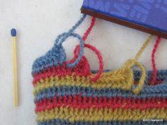 Striped nalbound mitten in Kaukola Kekomäen stitch in three colors on three separate needles.