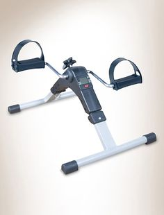 Folding Pedal Exerciser    Item # X1880    • low-impact workout for legs and arms  • ideal for rehabilitative purposes  • accelerates blood circulation  • 5-function digital display tracks exercise time, revolutions, RPM and calories  • scan feature alternately displays all measurements  • adjustable resistance knob  • weighs 10 lbs.  • anti-slip rubber pads prevent sliding and protect surfaces  • runs on button cell battery (included)  • fully assembled