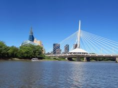 The stylish Esplanade Riel Footbridge crosses the Red River from St Boniface to The Forks at Winnipeg, Manitoba, Canada. Red River, Forks, Crosses, San Francisco Skyline, Opera House, Road Trip, Canada, Stylish, Building