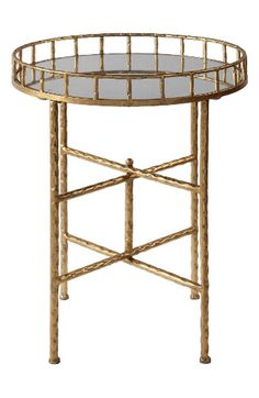 Free shipping and returns on Uttermost Tilly Accent Table at Nordstrom.com. A delicate accent table pairs a slim crossbar base in bright gold leaf with a round, mirrored tray top.