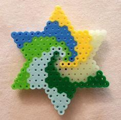 Glowing Swirl Star (Perler Beads) by right2bearcharms on DeviantArt